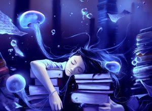 Menina a sonhar, deitada sobre livros