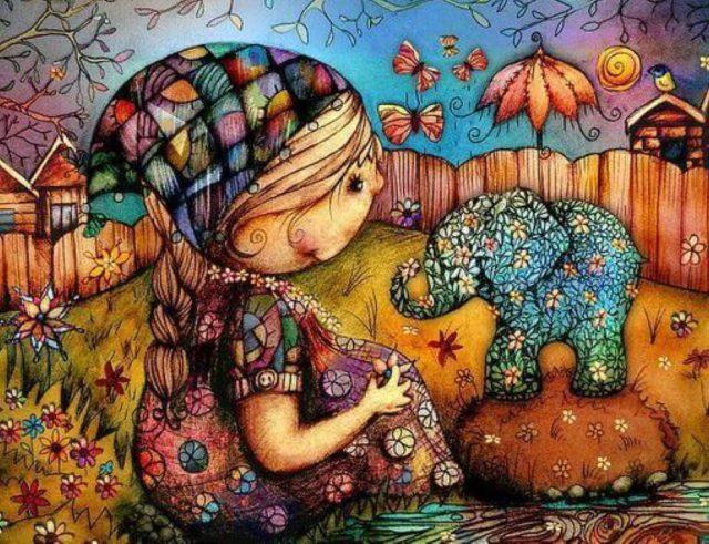Criança a brincar num mundo colorido