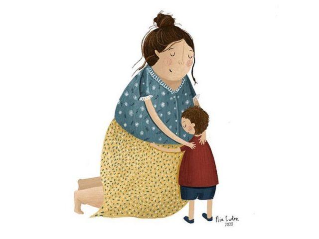 mãe abraça filho